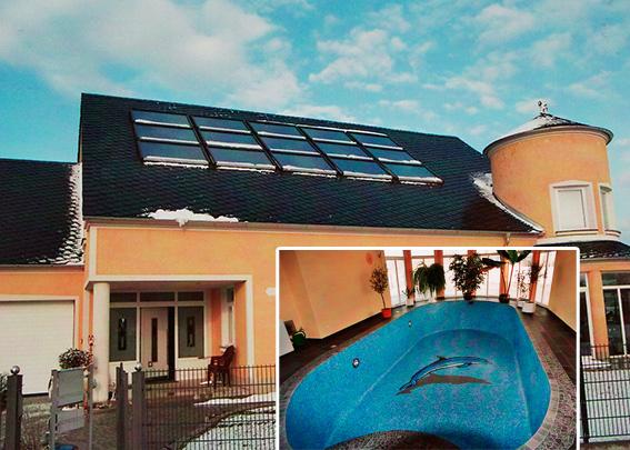 Privathaus mit Schwimmbad in Obermeitingen, Kollektor: ROTO Indach, Kollektorfläche: 43m², Speicher: OSKAR Schichtenspeicher, Speichervolumen: 2.000 Liter, Solardeckung: ca. 45 Prozent, Restheizung: Gasbrennwertkessel, Besonderheit: Die Solaranlage dient zur Heizungs- und Warmwasserunterstützung. Weiterhin wird das Schwimmbad rein mit kostenloser Solarenergie ganzjährig beheizt.